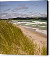 Waves Of Water And Grass Canvas Print by Thomas Pettengill