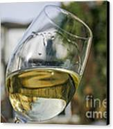 White Wine Swirling In A Glass Canvas Print by Patricia Hofmeester
