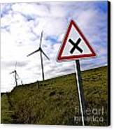 Wind Turbines On The Edge Of A Field With A Road Sign In Foreground. Canvas Print by Bernard Jaubert