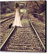 Woman On Railway Line Canvas Print by Amanda Elwell