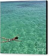 Woman Snorkeling By Turquoise Sea Canvas Print by Sami Sarkis