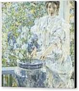 Woman With A Vase Of Irises Canvas Print