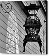 Wood Stoves Sold Here Canvas Print by Christine Till
