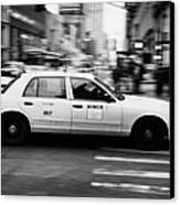 Yellow Cab Blurring Past Crosswalk And Pedestrians New York City Usa Canvas Print