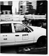 Yellow Cab With Advertising Hoarding Blurring Past Crosswalk And Pedestrians New York City Usa Canvas Print