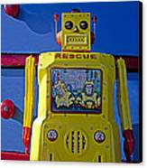 Yellow Robot In Front Of Drawers Canvas Print by Garry Gay