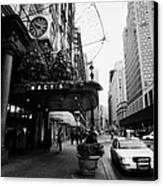 yellow taxi cab waits outside entrance to Macys department store on Broadway and 34th street Canvas Print by Joe Fox