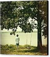 Young Boy Looking Out At The Water Under A Big Tree Canvas Print