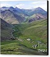 Yurts In The Tash Rabat Valley Of Kyrgyzstan  Canvas Print by Robert Preston