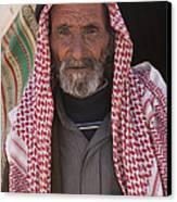 A Bedouin Man At The Camera In Front Canvas Print by Taylor S. Kennedy