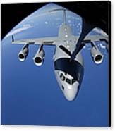 A C-17 Globemaster IIi Receives Fuel Canvas Print by Stocktrek Images