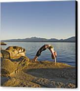 A Woman Does Yoga At Sunset Canvas Print by Taylor S. Kennedy