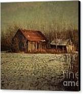 Abandoned Barn After The First Snow Canvas Print by Sandra Cunningham
