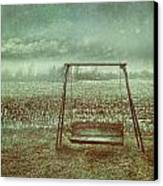 Abandoned  Swing In First Snow Storm Of Winter Canvas Print by Sandra Cunningham
