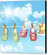 Baby Shoes And Teddy Bear On Clothline Canvas Print by Sandra Cunningham