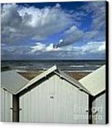 Beach Huts Under A Stormy Sky In Normandy Canvas Print