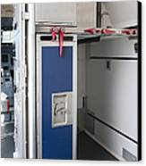 Food Compartment On An Airplane Canvas Print by Jaak Nilson