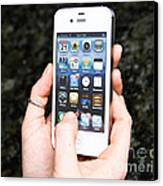 Hands Holding An Iphone Canvas Print by Photo Researchers, Inc.