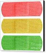Red Yellow And Green Bandaids Canvas Print by Blink Images