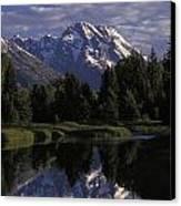 Reflection Of The Teton Mountans Canvas Print by Richard Nowitz