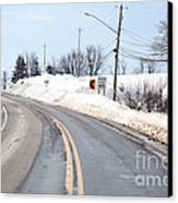 Snow By The Roadside Canvas Print by Ted Kinsman