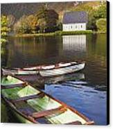 St. Finbarres Oratory And Rowing Boats Canvas Print by Ken Welsh