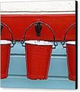 Three Red Buckets Canvas Print by John Short