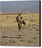 U.s. Marine Patrols A Wadi Near Kunduz Canvas Print
