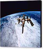 A Space Station In Orbit Above The Earth Canvas Print by Stockbyte
