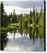 Calm Lake Reflection Canvas Print by Conny Sjostrom