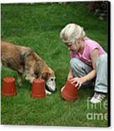 Girl Playing With Dog Canvas Print by Mark Taylor