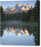 Mountain Reflections Canvas Print by Andrew Soundarajan
