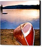 Lake Sunset With Canoe On Beach Canvas Print