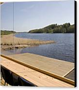 Lakeside Building And Dock Canvas Print by Jaak Nilson