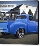 56 Studebaker At The Wigwam Motel Canvas Print by Mike McGlothlen