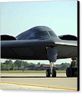 A B-2 Spirit Taxis Onto The Flightline Canvas Print by Stocktrek Images