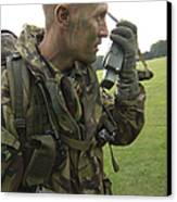 A British Army Soldier Radios Canvas Print by Andrew Chittock