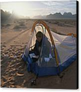 A Camper Reading In Her Tent Canvas Print by Gordon Wiltsie