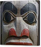 A Close View Of The Carvings Of A Totem Canvas Print