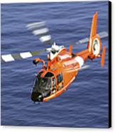 A Coast Guard Hh-65a Dolphin Rescue Canvas Print by Stocktrek Images