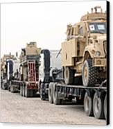 A Convoy Of Mine-resistant Ambush Canvas Print by Stocktrek Images