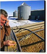 A Farmer Runs His Corn Through His Hand Canvas Print by Joel Sartore