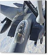 A Kc-135 Stratotanker Refuels An F-15e Canvas Print by Stocktrek Images