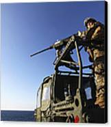 A Machine Gunner Mounts A M-2 Canvas Print by Stocktrek Images