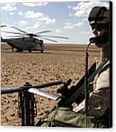 A Marine Assembles A Radio Antenna Canvas Print by Stocktrek Images