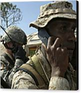 A Marine Communicates With Aircraft Canvas Print by Stocktrek Images