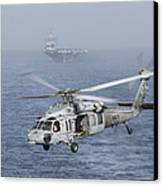 A Mh-60s Knighthawk Conducts A Vertical Canvas Print by Gert Kromhout