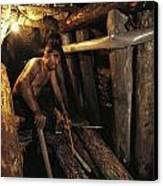 A Miner Works His Way Through A Jumble Canvas Print by Randy Olson