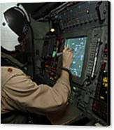 A Naval Flight Officer Tracks Aircraft Canvas Print by Stocktrek Images
