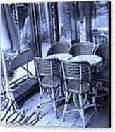A Parisian Sidewalk Cafe In Blue Canvas Print by Jennifer Holcombe